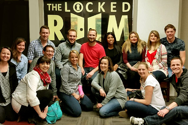 20 people participating at a Locked Room team building event in Calgary.